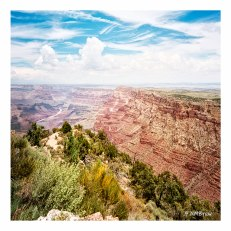 On the rim of the Grand Canyon, the Colorado is a thin line leading to other worlds.